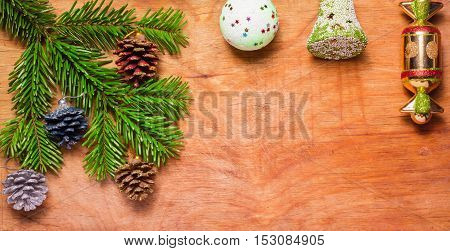 Christmas Tree A Green Twig And A Bell Ball On Wooden Old Rustic Background. New Year