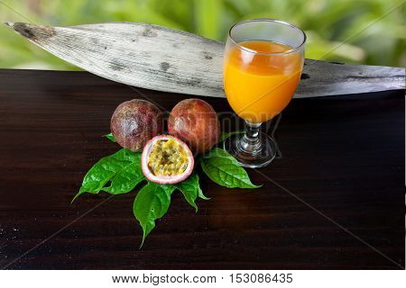 Passion fruit fresh and Passion fruit juice on wood table