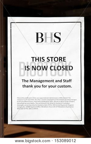 Carmarthen, UK, October 22, 2016 :  Store closed sign in the window of empty BHS department store in the city centre