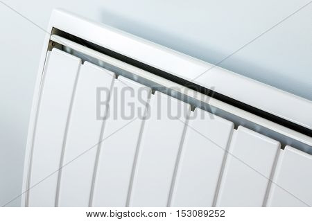 front view of modern radiator contiguous to a wall