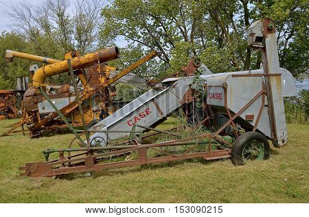 ROLLAG, MINNESOTA, Sept 1. 2016: An old old Case  pull combine operated by power take-off is displayed at the annual WCSTR farm show in Rollag held each Labor Day weekend where 1000's attend annually