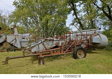 ROLLAG, MINNESOTA, Sept 1. 2016: Old Case  pull combines operated by power take-off are displayed at the annual WCSTR farm show in Rollag held each Labor Day weekend where 1000's attend annually