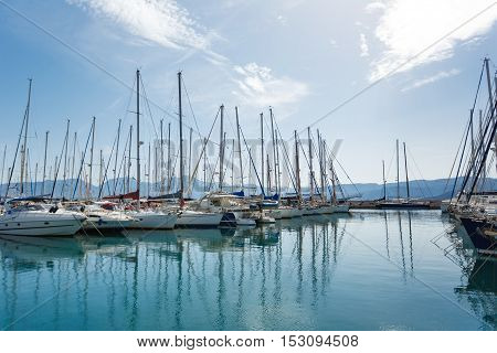 Yachts in a bay of greek city autumn time