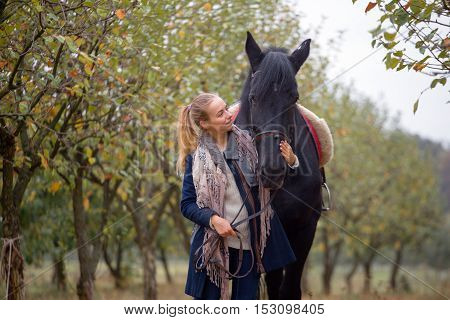 Beautiful Stylish Girl In A Cowboy Hat With A Horse Walking In The Autumn Forest, Country Style