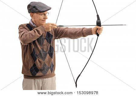 Elderly man aiming with a bow and arrow isolated on white background