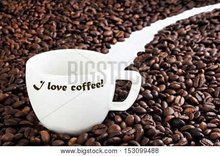 Cup With The Inscription On The Background Of Coffee Beans