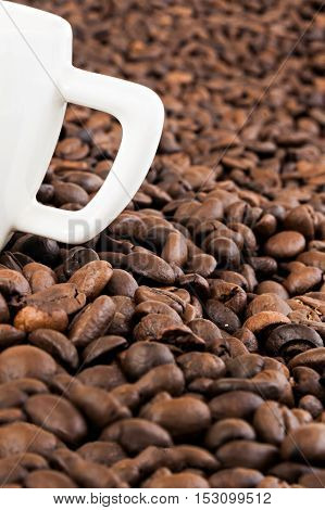 White Coffee Cup On The Background Of Coffee Beans
