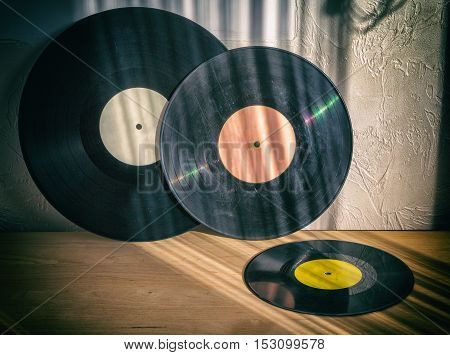 Black Vinyl Close-up of old records on a wooden table retro vintage items