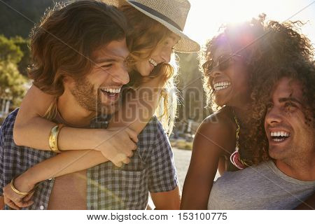Two couples drinking on the beach, backlit, close up, Ibiza