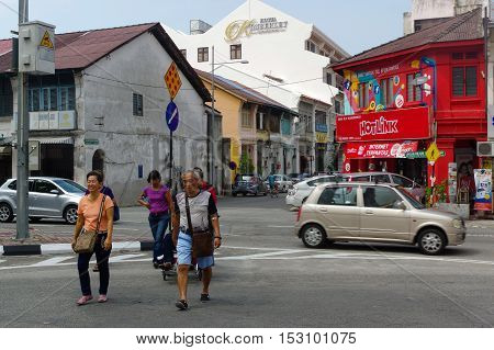 Georgetown Penang Malaysia - April 18 2016 : few local people and cars walking driving around the street