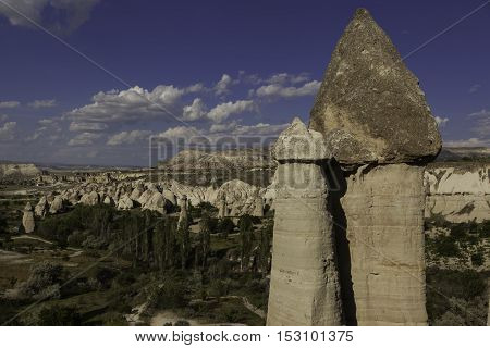Top of prehistoric rock formations in front of Love velley in Turkey shot during cloudy day