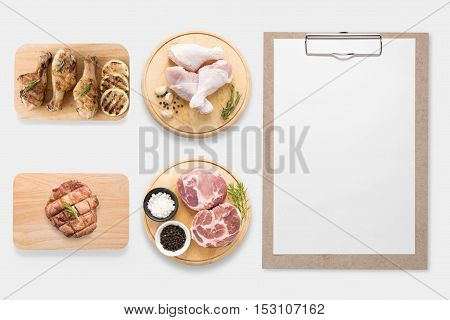 Design Concept Of Mockup Clipboard And Pork, Chicken Drumstick On Cutting Board Set Isolated On Whit