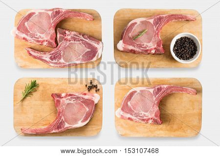 Top View Raw Bone-in Pork Rib Chops Steak Set Isolated On White Background. Clipping Path Included O