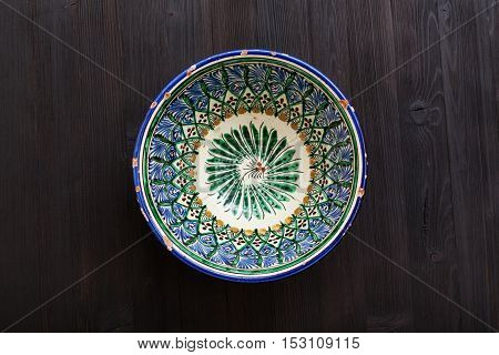 Traditional Central Asian Bowl On Dark Brown Table
