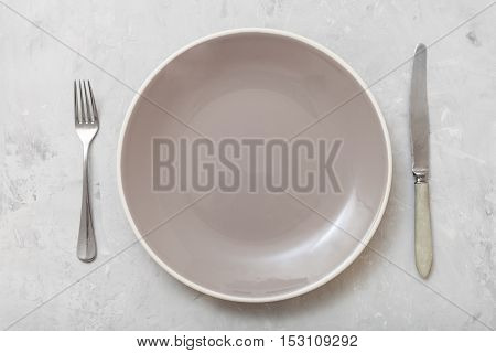 Top View Gray Plate With Knife, Spoon On Concrete