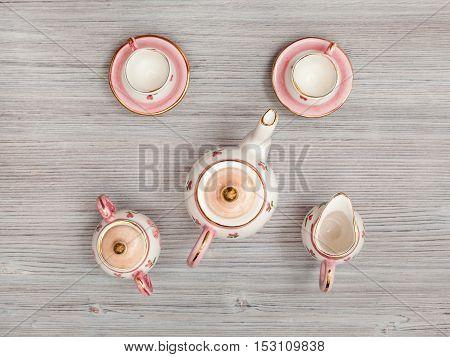 Pink Porcelain Tea Set On Gray Brown Table