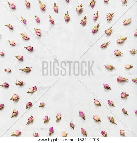 Round Frame From Pink Rose Flower Buds On Concrete