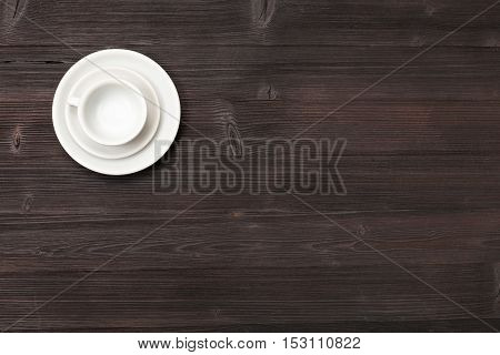 Top View Of Cup With Saucers On Dark Brown Table