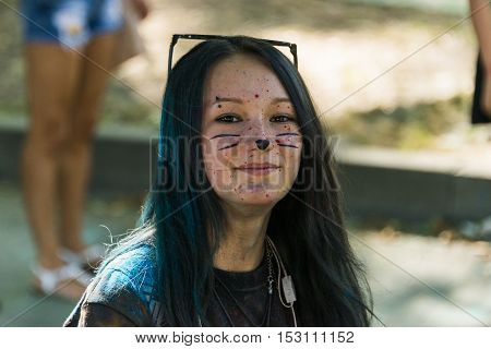Lviv Ukraine - August 28 2016: Gir in cat make-up l having fun during the festival of color in a city park in Lviv.