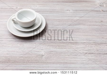 One White Cup With Saucers On Gray Brown Table