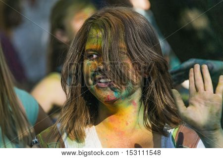 Lviv Ukraine - August 28 2016: Girl having fun during the festival of color in a city park in Lviv.