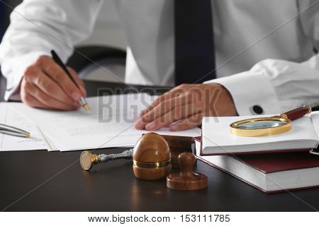 Ink pad, stamp, magnifier and books in notary public office