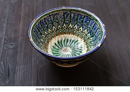 Traditional Central Asian Bowl On Dark Brown Board