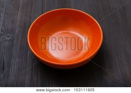 Orange Bowl On Dark Brown Board