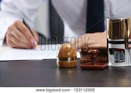 Stamps and ink pad on notary table