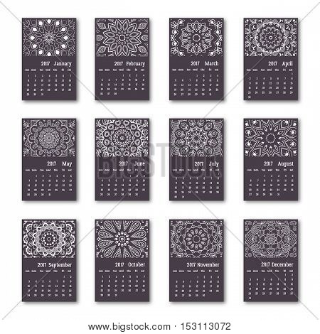 Calendar 2017 start sunday with hand drawn mandala. Vintage oriental style black and white colors. Vector illustration.