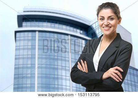 Businesswoman on blurred building background