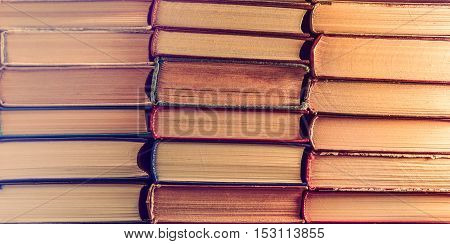 Stack of old vintage books. Education background