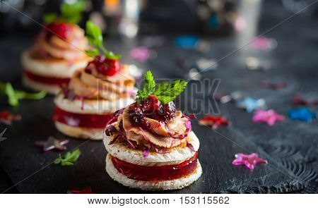 Festive appetizer with foie gras, cranberry chutney and jelly