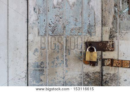 Old wooden door locked with golden padlock - Old town in Thailand