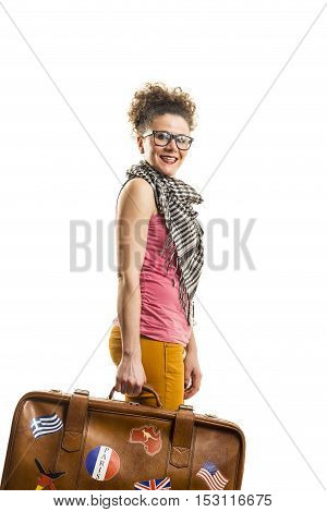 Young girl holding a suitcase studio shot
