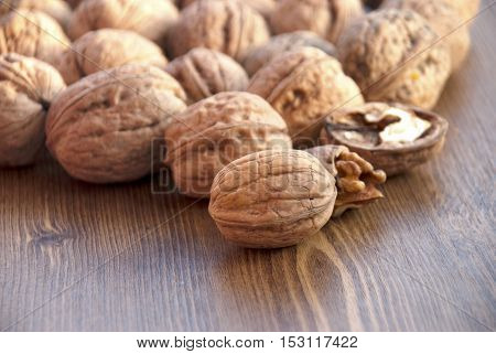 walnuts on the wooden-table.Walnuts, wooden Background, Cracked, Small Group of Objects, Horizontal
