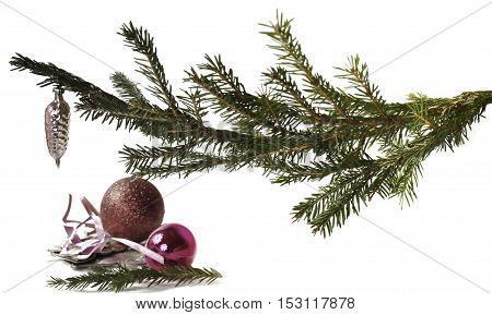 New Year decorations and branch of Christmas tree. On a white background.