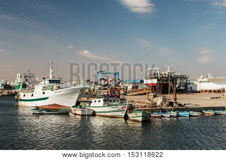 Fishing Boats in a Harbour and a Blue Sky. Tunisia.