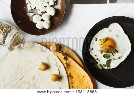 breakfast with eggs flat cakes and tea