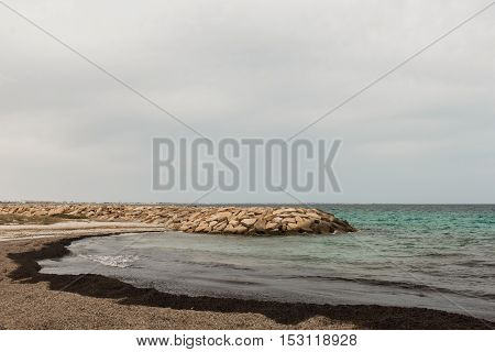 The view from the shore to the barrier of stones in the clear Mediterranean sea. Tunisia, Mahdia. HD