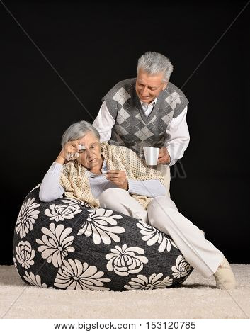 Portrait of a elderly man brings his wife medicine