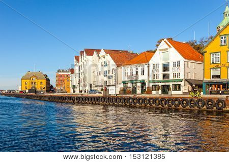 STAVANGER, NORWAY - OCTOBER 14, 2016: People at the quay port with many restaurants and pubs in the city centre of Stavanger. Stavanger is one of most famous cruise travel destinations in Europe.