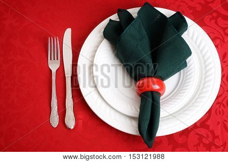 top view of christmas place settings with knife and fork