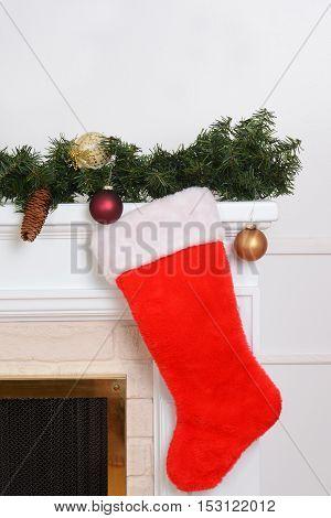 closeup santa sock on fireplace with garland