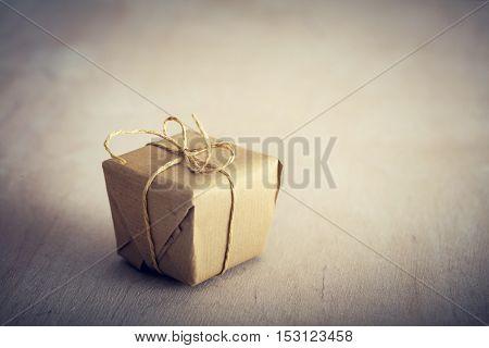 Rustic retro gift, present box. Christmas time, vintage mood. Handmade eco paper wrap.