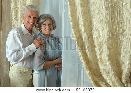 Portrait of beautiful mature couple  near window