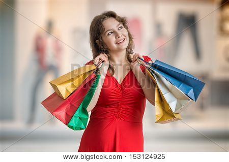 Young Happy Pretty Woman Is Shopping And Holds Shopping Bags.