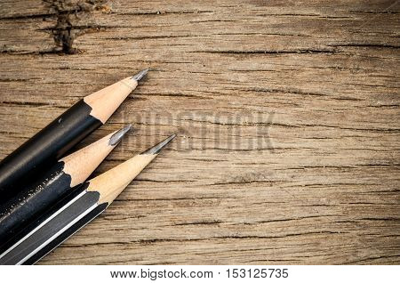 pencil and eraser on wooden table, stationary