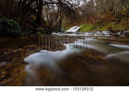 View of a river with an waterfall in the forest, Strandzha mountain, Bulgaria