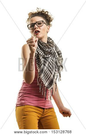 Studio shot of a young hipster girl singing and dancing